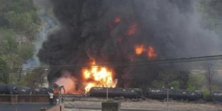 Train carrying crude derails in Virginia town, bursts into flames