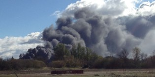 Train derails in central Saskatchewan, catches fire