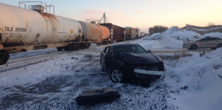 Woman hurt in car vs. train accident