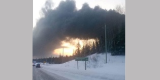 Fire burning after train carrying crude oil derails in Northern Ontario