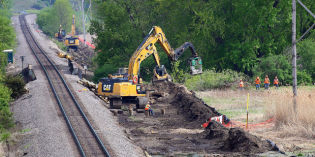 Marsh work proceeds as legal case grinds on
