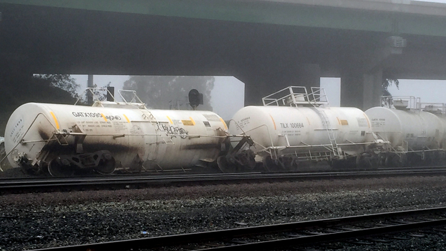 Tanker cars lay on their sides after derailing in Martinez early Wednesday.  (Nate Gartrell/Bay Area News Group)