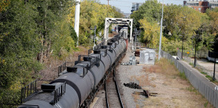 Crude by rail shipments down by half as North Dakota oil production hits two-year low