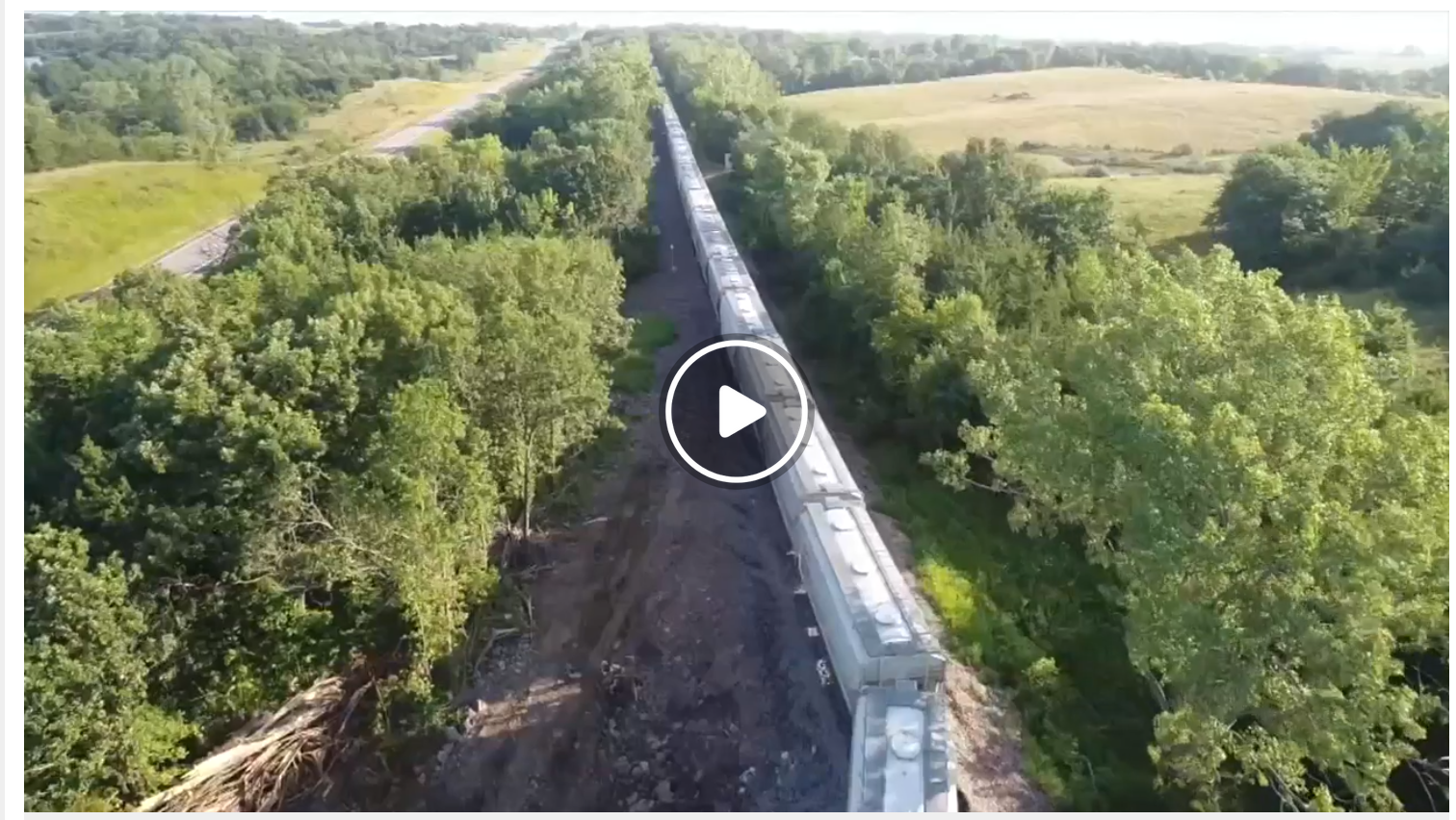 Nearly 70 train cars hauling frac sand derail along tracks